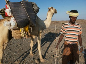 Photograph by Paul Salopek Ibrahim Hagaita, the Djiboutian cameleer, leads Madoita, the solar camel.
